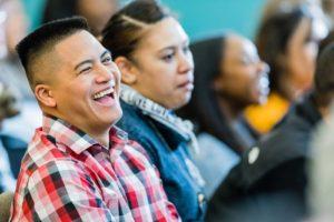 laughing audience at seminar